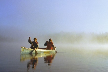 two people paddling in one Canoe on Bells Lake