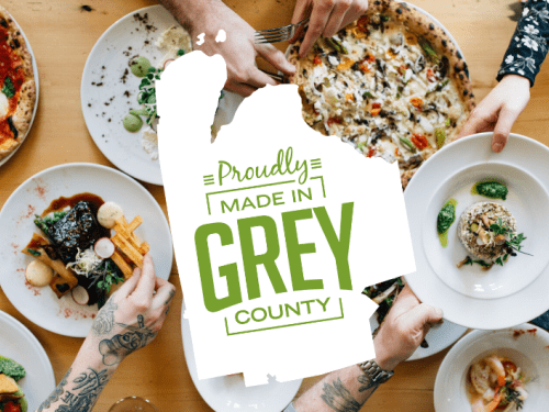 Made in Grey logo over a table laden with food