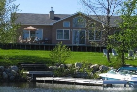 Lakeside B&B exterior view, located steps from the water, private dock and beach