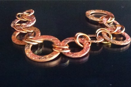 Copper, fire painted with a torch, hand shaped links and clasp