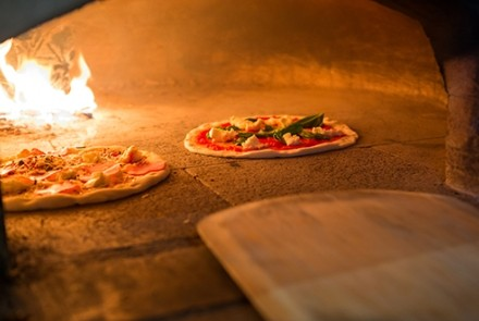 pizza in wood fire oven