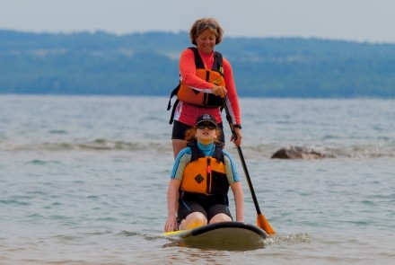 mother and daughter on stand-up paddleboard at Sarawak Beach