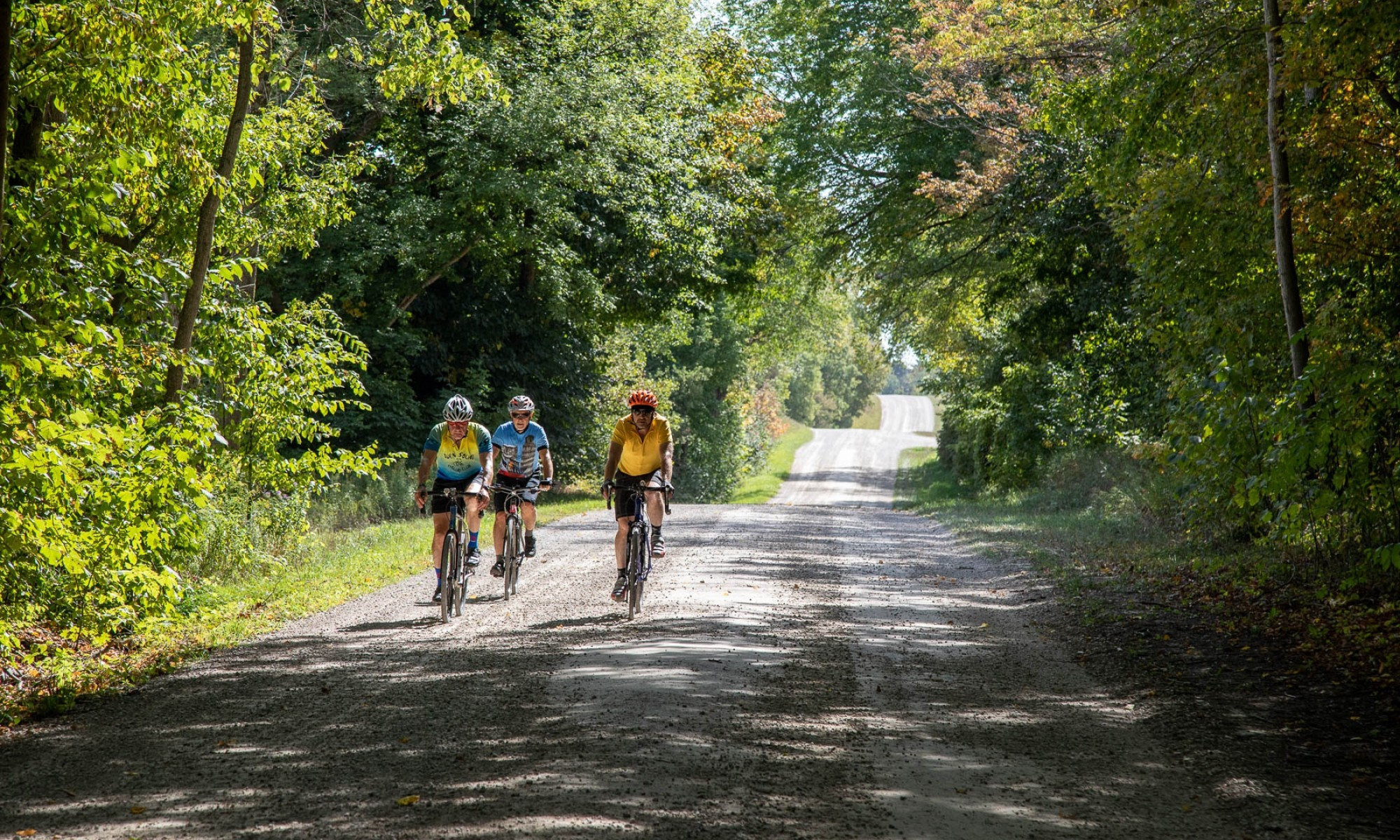 Three cyclists on Gravel Road