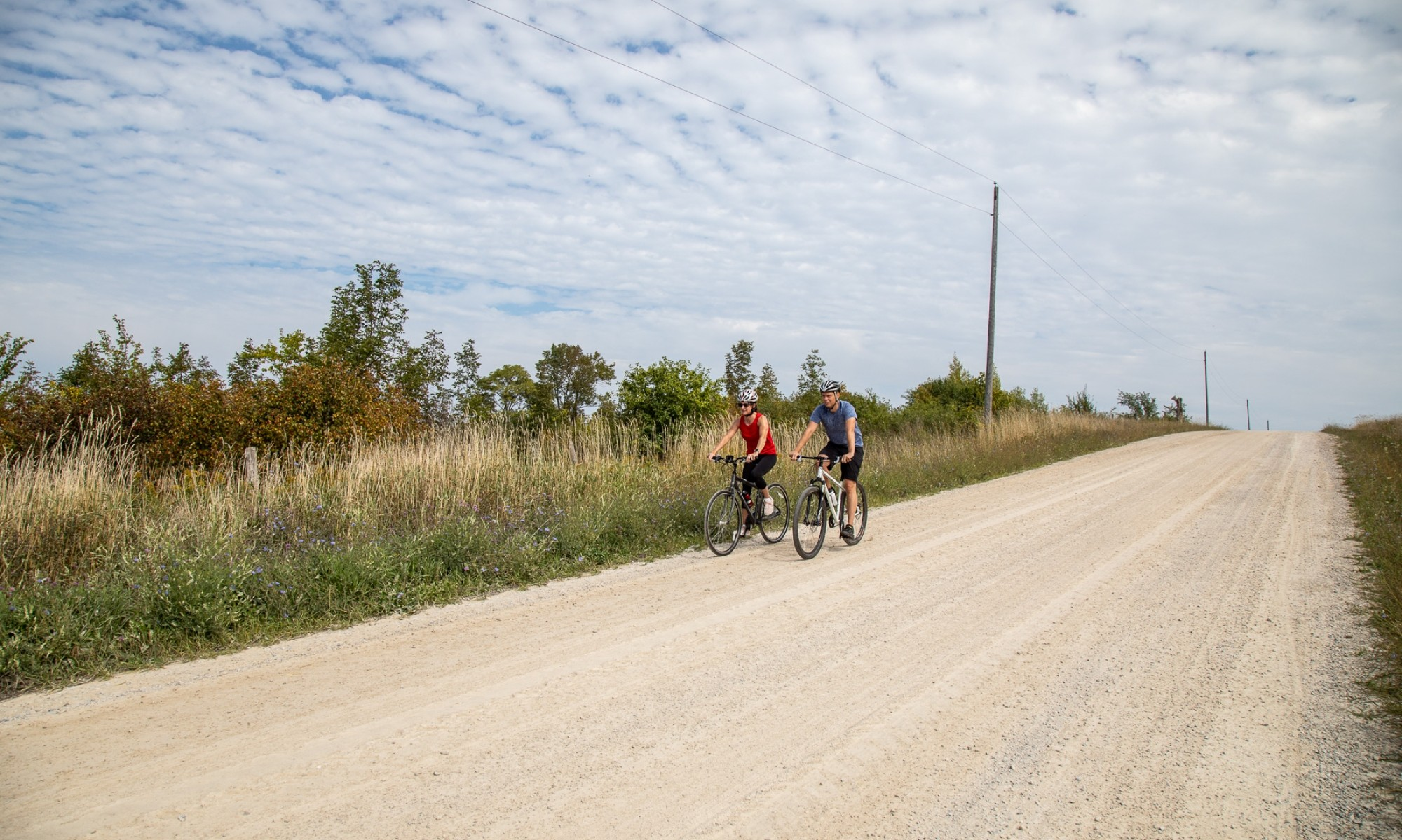 Two cyclists on a gravel road