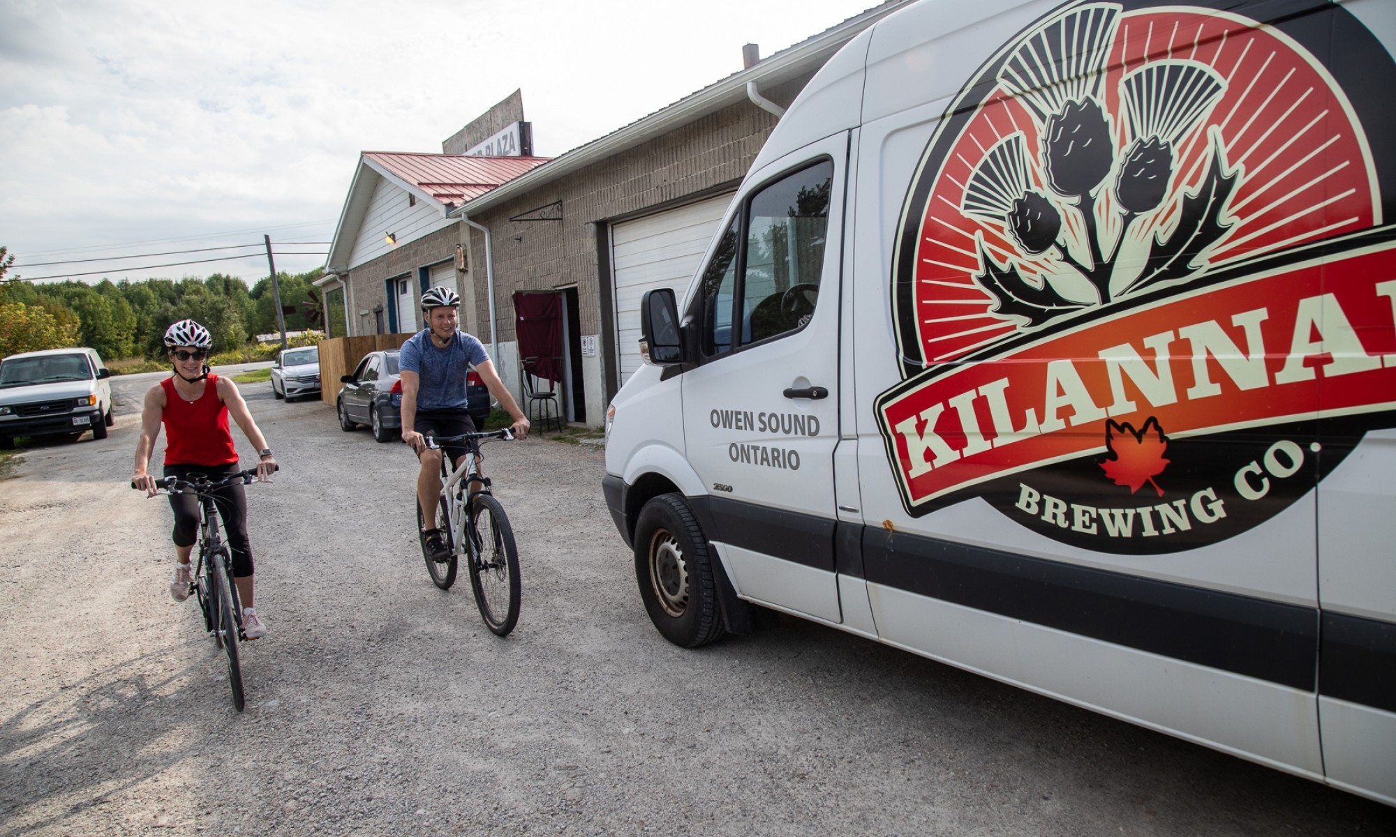 Two cyclists by Killanan truck