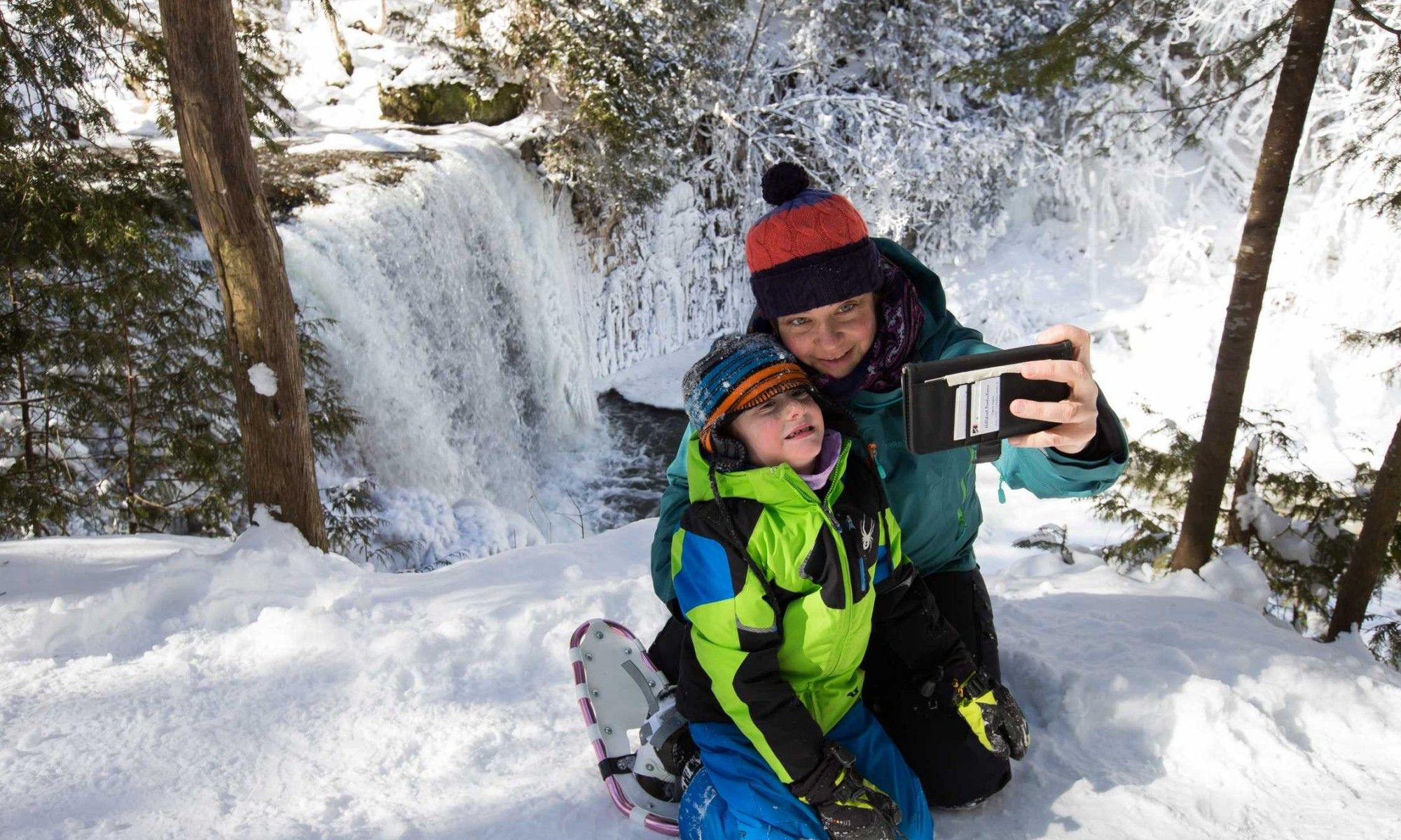 Rheanna and her son snowshoeing