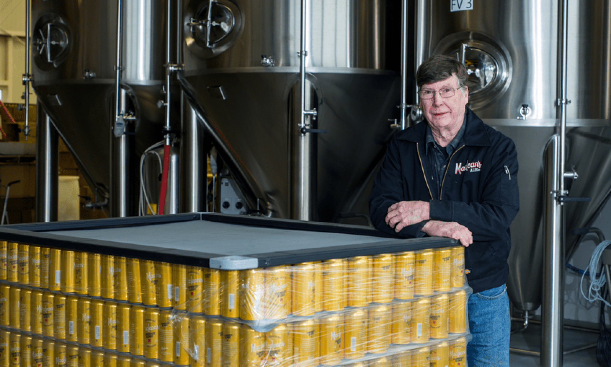 Charles Maclean with a crate of cans