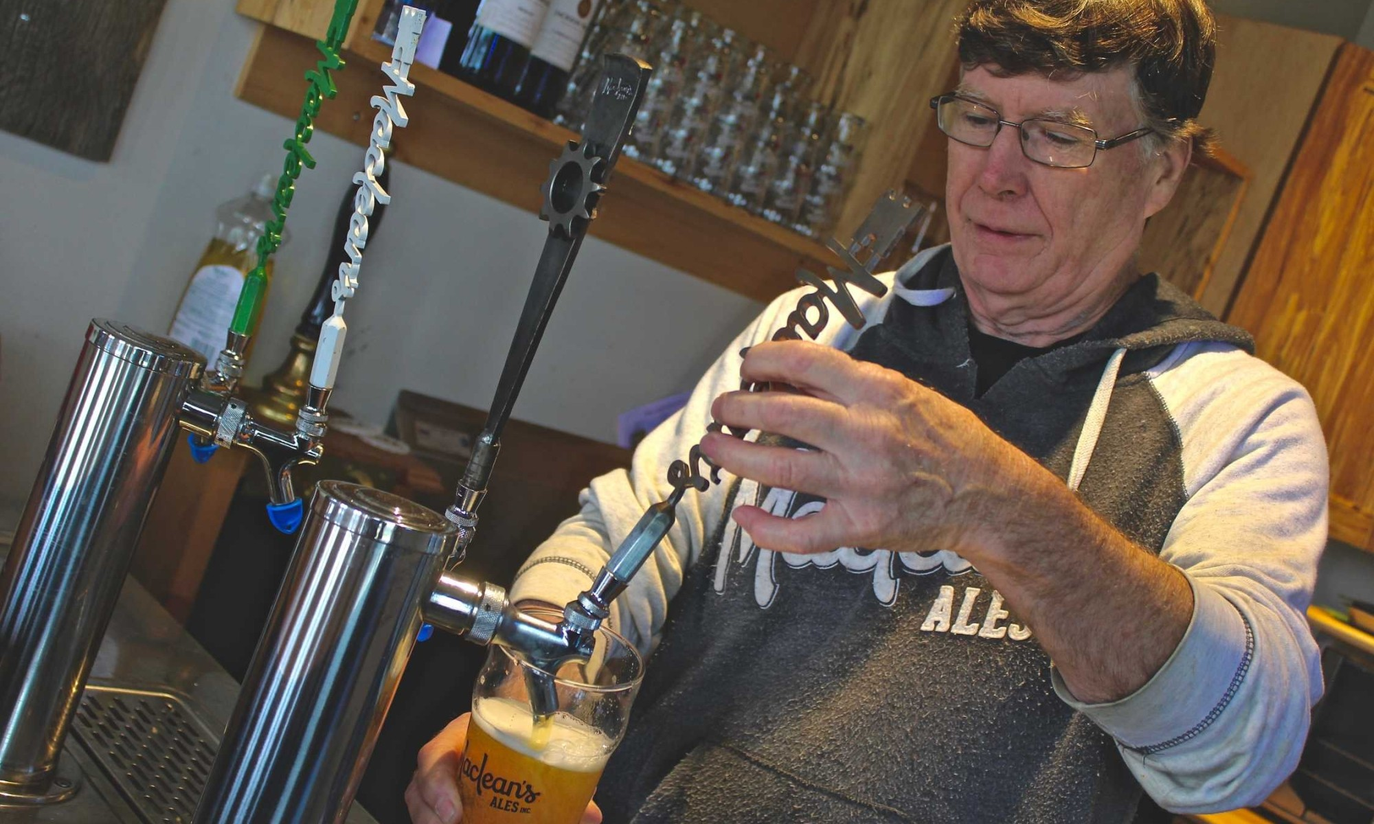 Charles pouring a beer