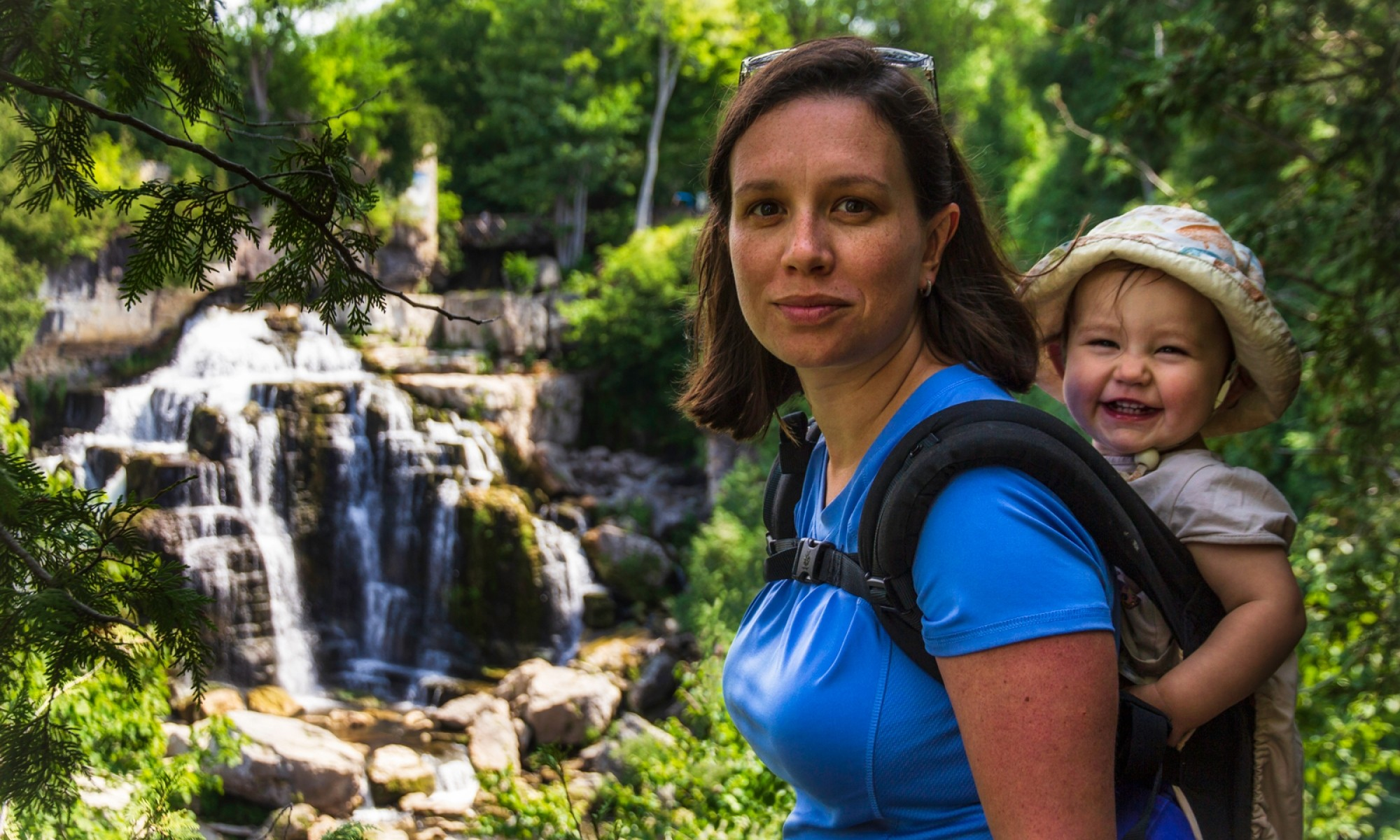 Mother and baby hiking at Inglis Falls