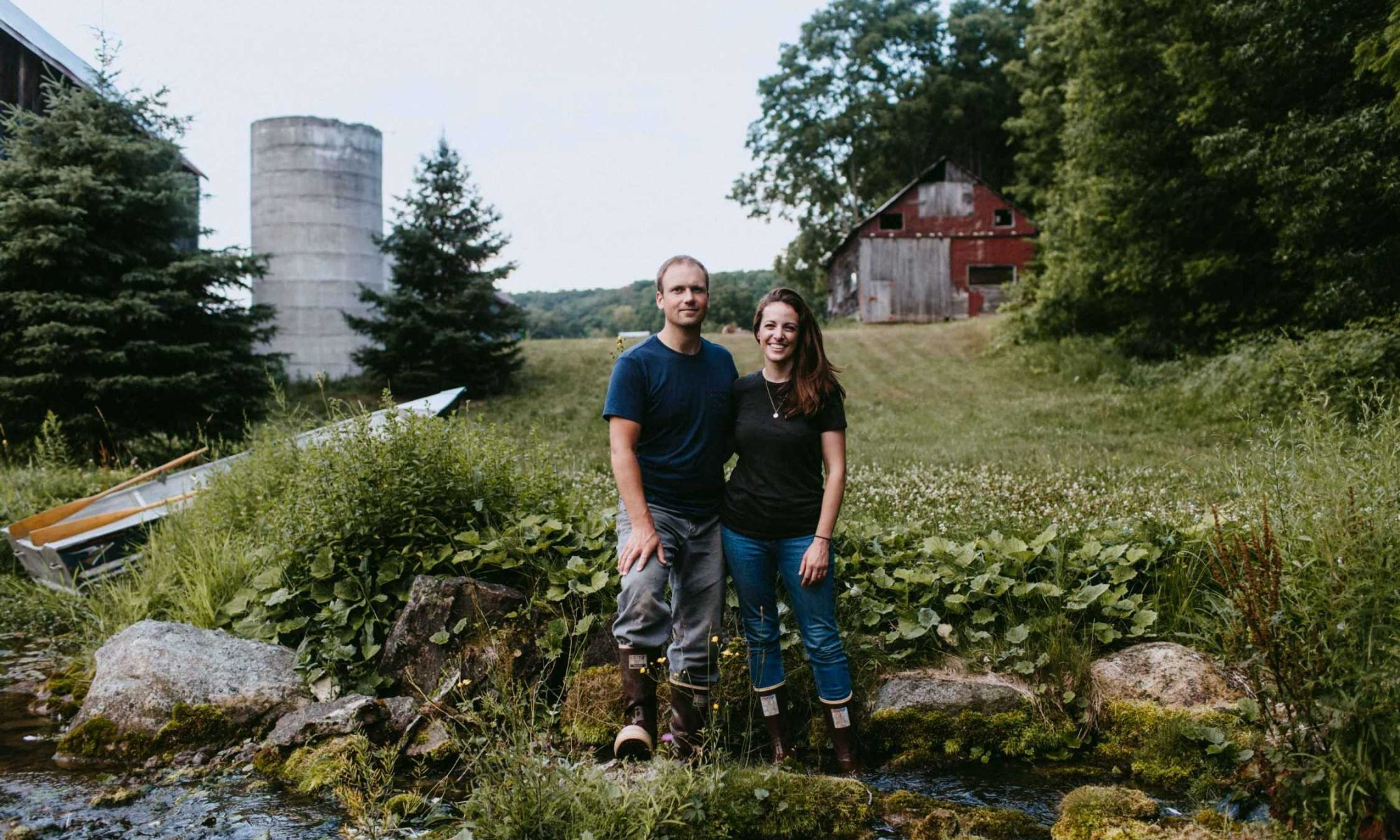 Courtney and John at their new home on the Farm
