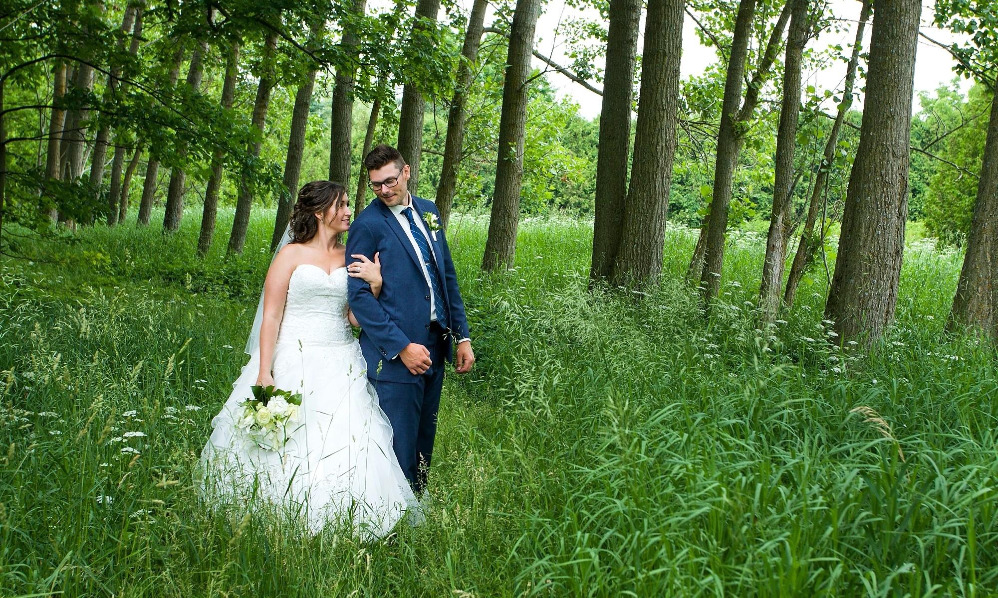 newlywed couple walking in the garden
