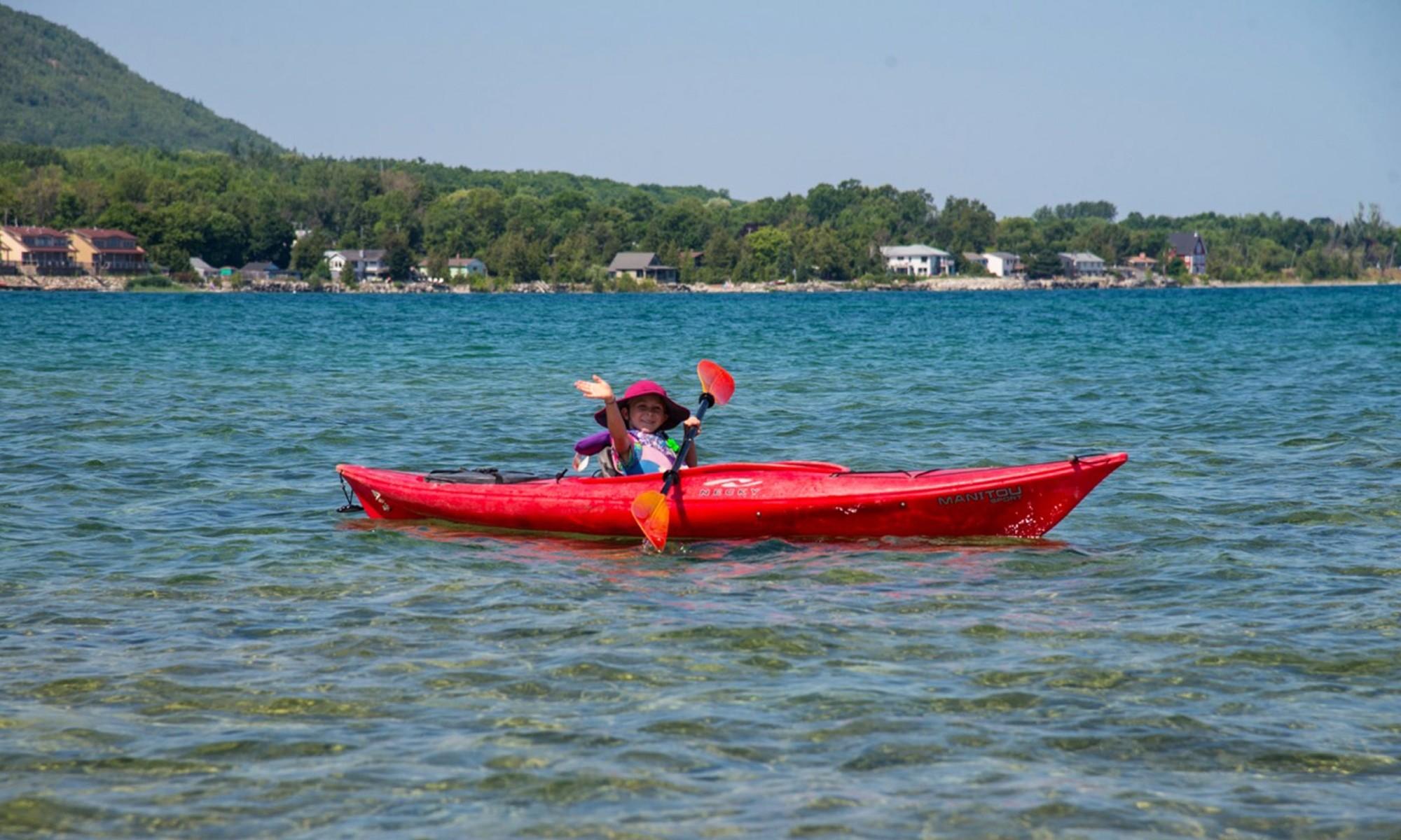 Hannah kayaking on Georgian Bay near Northwinds Beach